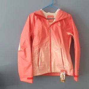 Brand new coral/ salmon colored North Face jacket